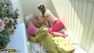 Young couple plays with kinky inflatable toy