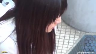 Young Japanese woman caught peeing in public