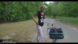 Granny with pierced pussy rides a bike and gets nailed outdoor by a pierced cock