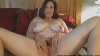 Chubby brunette cougar enjoys toying her hairy pussy